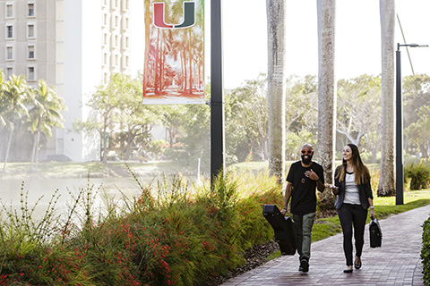 Two students walking to class at the University of Miami Coral Gables campus